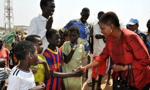 Humanitarian chief Valerie Amos (right) is greeted by children during a visit to Malakal town in Upper Nile State, South Sudan.