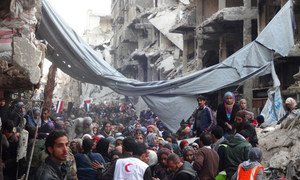 Desperate crowd awaits relief aid at Yarmouk Palestinian refugee camp in Damascus.