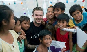 UNICEF Goodwill Ambassador David Beckham visits with children in Tacloban, Philippines.