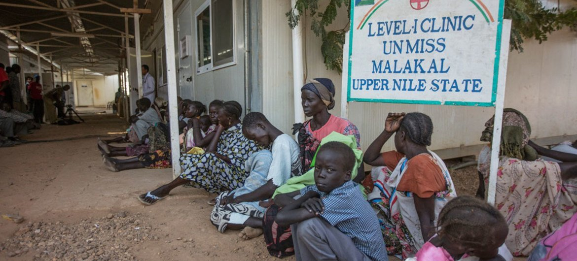 Residents at the camp for internally displaced persons (IDPs) at the UN Mission for South Sudan (UNMISS) Malakal Base in the Upper Nile State wait in line at the base's health facility.