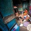 A family living in an urban slum in Sonagachi, Kolkata, India.
