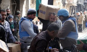 UNRWA distributing humanitarian aid at Yarmouk camp, Damascus, Syria, on 7 February 2014.