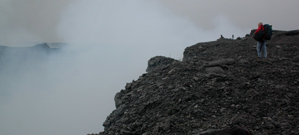 Standing on the rim of Nyamuragira volcano near Goma, Democratic Republic of the Congo (DRC). MONUSCO has been supporting scientific research on the volcano.