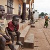 Ten-year-old Prophète (left) and his friend Ardi, 7, live on the streets in PK5, one of the last neighborhoods in Bangui, Central African Republic, where Christians and Muslims still live side by side.