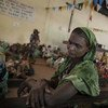 A displaced Central African Republic (CAR) woman ponders her situation in the shelter of a church in Boali, a town north of the capital Bangui.