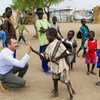 Toby Lanzer interacts with children at the Nyeel refugee camp in South Sudan (March 2013).