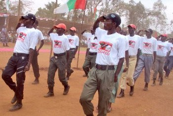 Members of Burundi's ruling party youth wing march at a rally in September 2012.