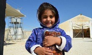 Jordan, Zaatari Refugee Camp, 2013. A little girl received dates distributed by WFP.