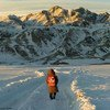 A little girl walks to school in Western Mongolia at the foot of the Altai Mountains, is several kilometres long and in freezing temperatures.