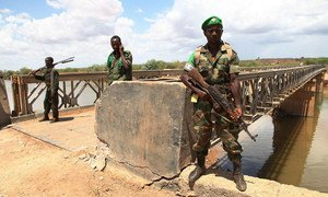 African Union troops guard a bridge over the Juba river near the town of Burdubow which they regained control of from Al Shabaab insurgents on 9 March 2014 during a joint operation with Somali National Army troops.