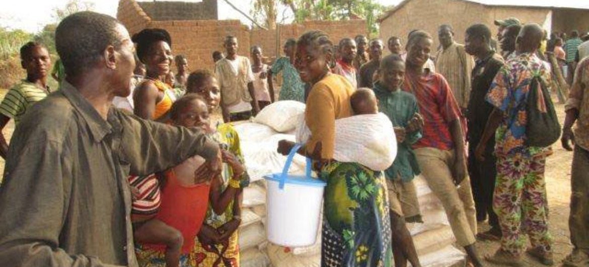 A mother's smile: a woman and her child pick up vital food rations from WFP in the Central African Republic (CAR).