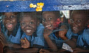 Grammar school students from the Herman Gmeiner High School in SOS Village, Matadi Estate, Monrovia, laugh at the photographer during an outreach event by UNMIL celebrating UN4U Day, in Liberia.