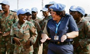 A female UN Police officer jokes around with a peacekeeping colleague at the African Union-United Nations Hybrid Operation in Darfur (UNAMID).