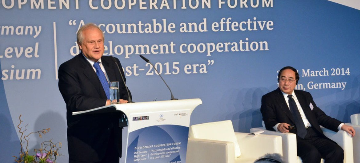 ECOSOC President Martin Sajdik  (at podium) and Wu Hongbo, USG for Economic and Social Affairs, attending Development Cooperation Forum High-level symposium in Berlin.