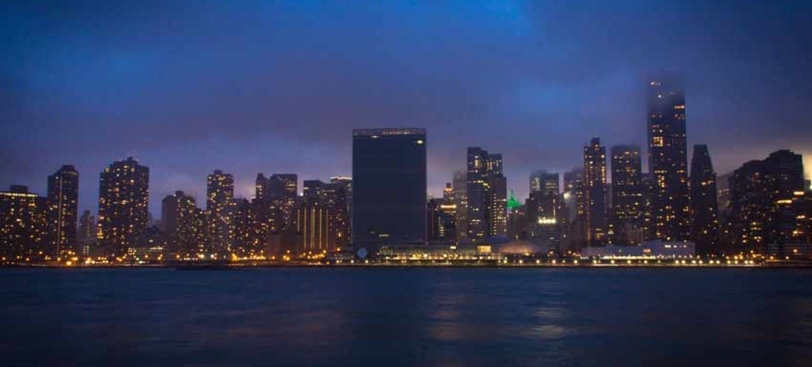 """""""Lights out"""" for the United Nation Headquarters complex in New York in observance of """"Earth Hour,"""" an annual global event raising awareness about the need to take action on climate change and promoting sustainable energy consumption."""