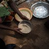 A woman sifts through seeds at a camp for people displaced by violence in the Central African Republic.