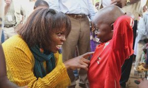 WFP Executive Director Ertharin Cousin speaks to a little boy in the Central African Republic during her visit in late March 2014.