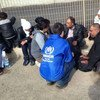 UNHCR staff talk with some of the growing number of people making the dangerous crossing of the Mediterranean to Italy.