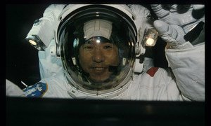 A close-up of UNOOSA space applications expert and astronaut Takao Doi aboard Columbia.