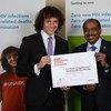 UNAIDS Executive Director Michel Sidibé (right) with new International Goodwill Ambassador, Brazilian football star David Luiz.