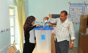 Casting a ballot in Basra, Iraq, where more than 1.6 million voters were registered for the parliamentary elections on 30 April 2014.