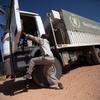 10 February 2014. El Fasher: A World Food Programme (WFP) truck driver on a trip from El Fasher to Shangil Tobaya, North Darfur. UN Photo/Albert Gonzalez Farran