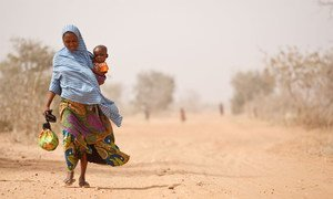 A woman and her severely malnourished son leave a UNICEF-supported health centre, in Maradi Region.