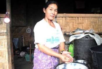 A Kachin woman prepares dinner outside her home at an IDP camp outside Myitkyina in Myanmar's northern Kachin State.