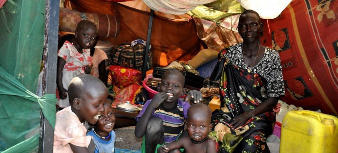 A family sitting inside a makeshift shelter at the UN compound in Malakal, Upper Nile State, South Sudan.