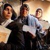Mujeres palestinas en un centro de distribución de ayuda de la UNRWA en Damasco  Foto:UNRWA/Carole Alfarah