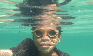 Young Timorese fisherman wearing his wooden goggles to catch fish along the shores of Atauro island off Dili.