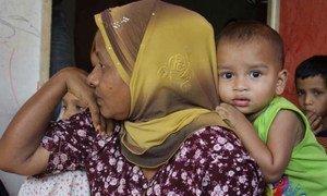 Des gens arrivés en Malaisie après un long voyage en bateau depuis l'Etat de Rakhine, au Myanmar. Photo HCR/B. Baloch