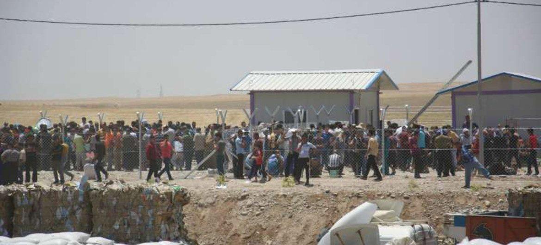 Iraqis fleeing vioelence in Mosul arrive in the Kurdistan region.
