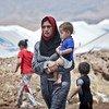 Familia desplazada por la violencia en Iraq.  Foto: ACNUR/S. Baldwin