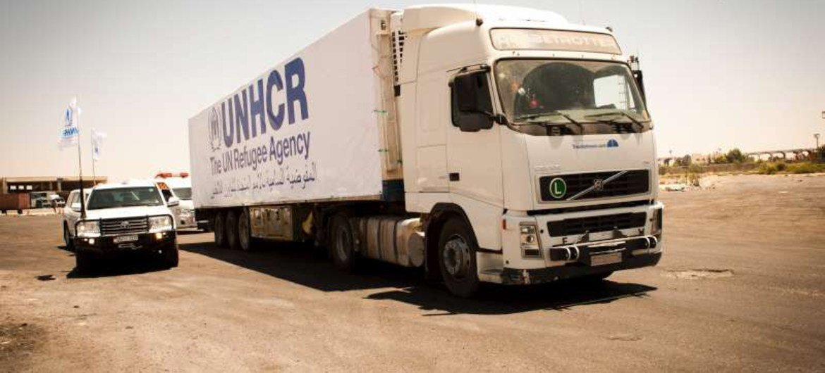 A UNHCR container truck heads for Sweida with aid to be distributed to needy Syrians displaced within the south of their country.