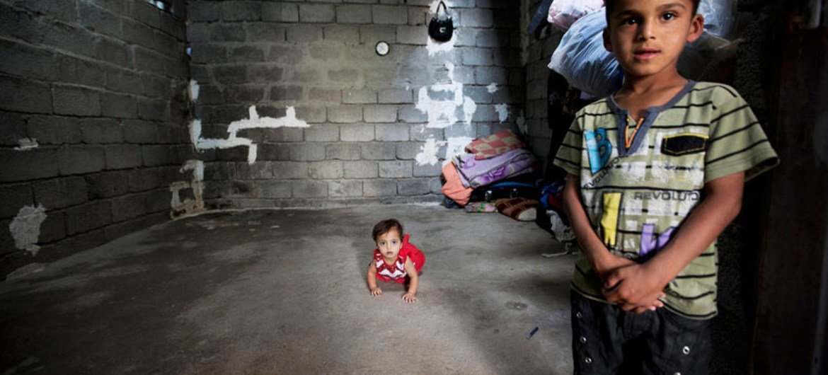 Two small children who fled the escalating violence in Iraq (file photo).