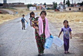 Una madre y su hija desplazadas por la violencia en Mosul, Iraq  Foto: ACNUR/S. Baldwin