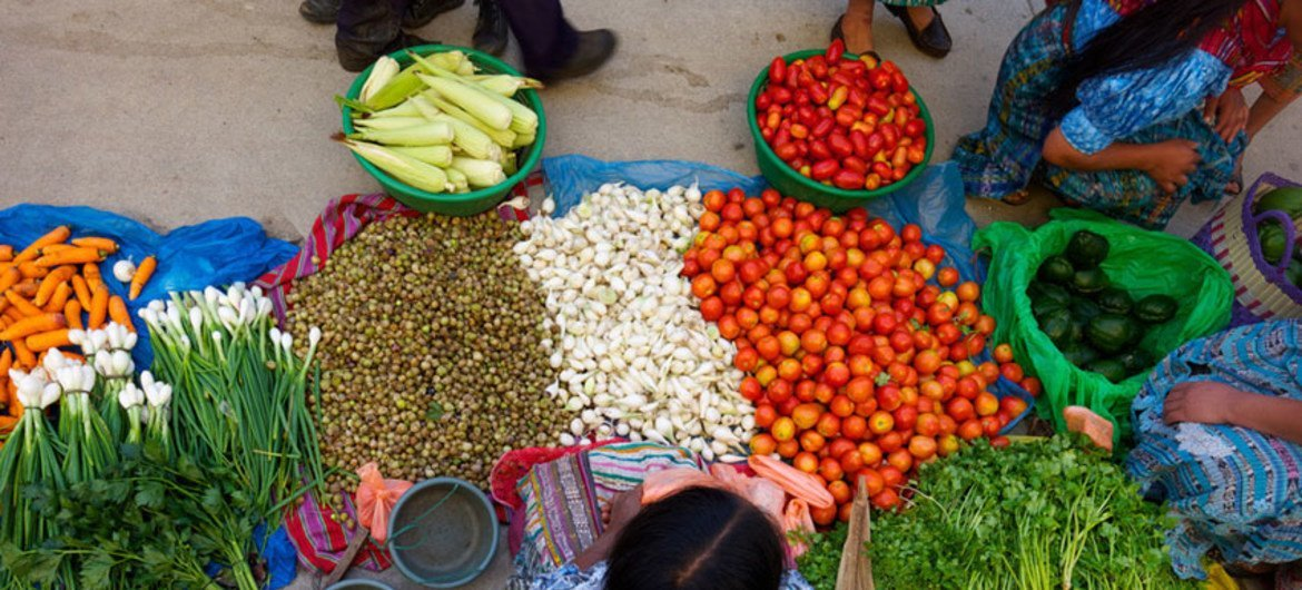 A member of an agricultural cooperative, AGRISEM. sells vegetables at the Chicamaìn market in Guatemala. IFAD/Santiago Albert Pons