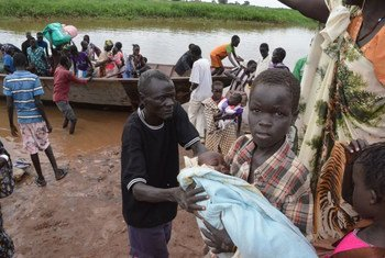 South Sudanese refugees, many of them women and children, arrive by boat in Ethiopia.
