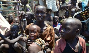 Nyaman Joak, 35, with 16-month-old Boum at Ethiopia's Pagak entry point, waiting to be registered as a refugee.  It took 10 days for Joak to walk here from her home in South Sudan's Upper Nile state. Three of her children died in the fighting, and she doesn't know where her husband is.