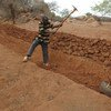Terracing lands helps to reduce soil erosion and run-off, thereby improving farmers' chances of higher yields.