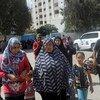 Familias palestinas buscan refugio en una escuela de la UNRWA en Gaza  Foto. UNRWA