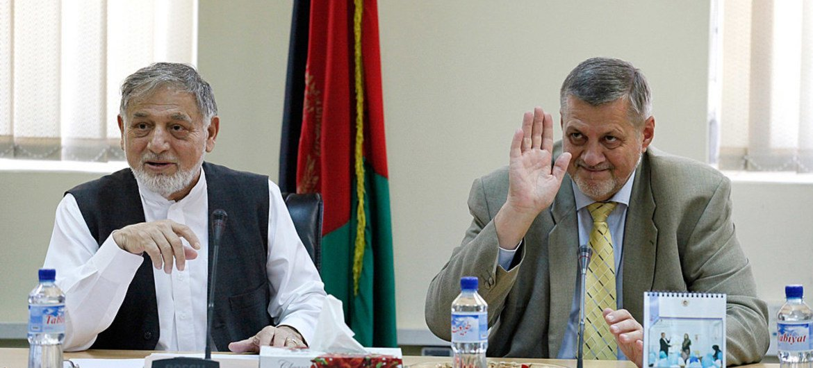 Special Representative for Afghanistan and head of UNAMA, Ján Kubiš (right), with Chairman Ahmad Yusuf Nuristani of the IEC Board of Commissioners following a meeting of the IEC.
