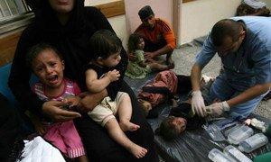 Medics care for children injured in airstrikes in Rafah, south Gaza.