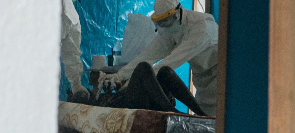 Doctors from the Liberian Ministry of Health, working with personnel from WHO and Médecins Sans Frontières (MSF), attend to a patient quarantined at a Liberian ebola isolation unit in the capitol city Monrovia.
