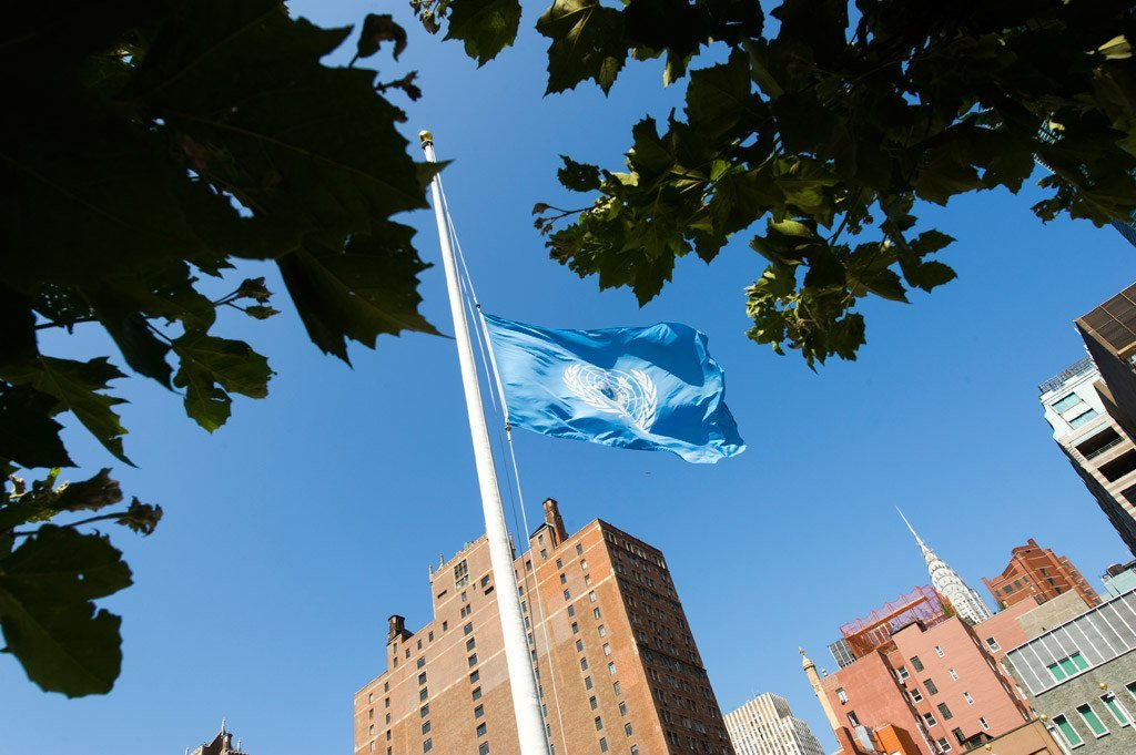 The UN flag flies at half-mast at the Organization's Headquarters in New York, in memory of fallen colleagues.