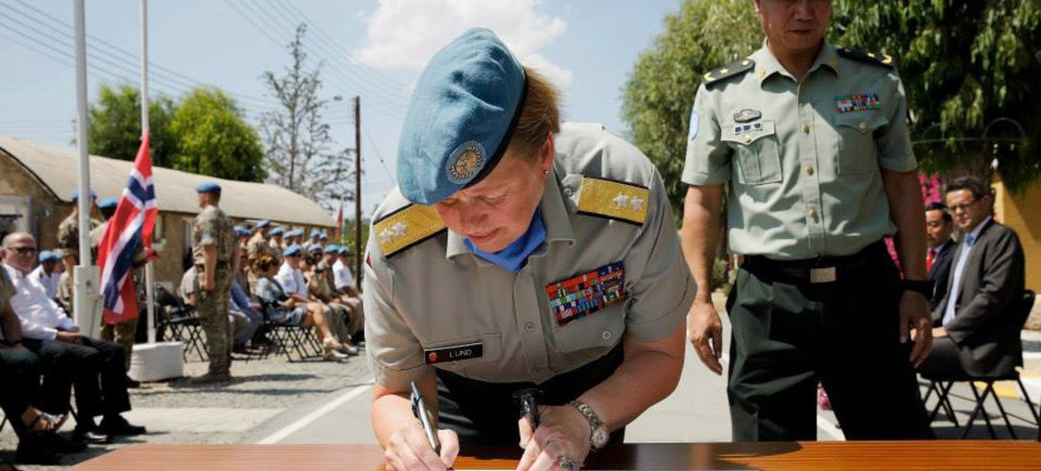 Major-General Kristin Lund signing the hand-over document with outgoing Major General Chao Liu at the UN peacekeeping force in Cyprus headquarters.