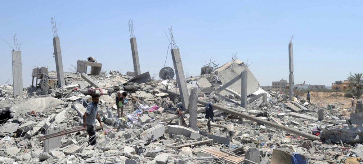 Palestinians search the rubble of destroyed homes in Khuzaa, east of Khan Younis, Gaza Strip.