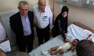 During his visit to Gaza, WHO's Regional Director Dr Ala Alwan (left) spoke with patients and health workers at Mohammed Al Durrah Pediatric Hospital.