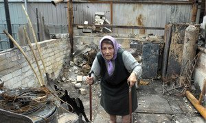 A resident of the Artema suburb of Sloviansk, Ukraine, in the rubble of what used to be her summer kitchen, in July 2014.